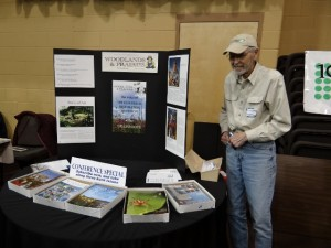 Rollie Henkes staffing his Woodlands and Prairies table.
